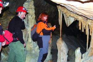 Photo special to the Times/Matt Bowers, National Speleological Society Chief of Natural Resources at Great Basin National Park, Ben Roberts (L), guides international cave artist Carolina Shrewsbury through the park's Lehman Caves. Shrewsbury is working on the development of a new mural dedicated to the historical discovery of the cave.