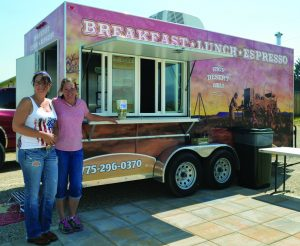 Times photo by Marty Bachman Cari Gregerson (left) and Wendy Hecker, working the High Desert Deli food truck, which is now located on Great Basin Highway across the street from South Fork Hardware.