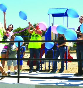 Times photo/Marty Bachman Family members of former Ely Police Chief Jack Caylor, release balloons in his honor at a ceremony held last Saturday at the newly named Jack Caylor Park.