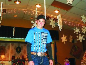 Times photo/TERESA STEWART Cameron Brazell last year modeling clothes from Andy's Western Wear