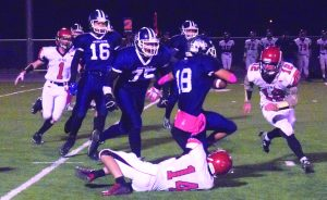 David Maxwell Dakota Barela makes good yardage before being tackled in the game with Lincoln County.  Lincoln won 48-21.  The Bobcats hosts West Wendover this Friday night.