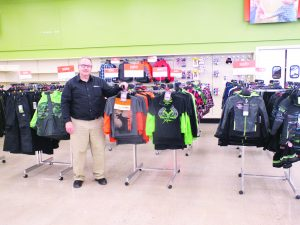 Courtesy photo Shopko manager Tom Sandt shows off some of the new store's wares.