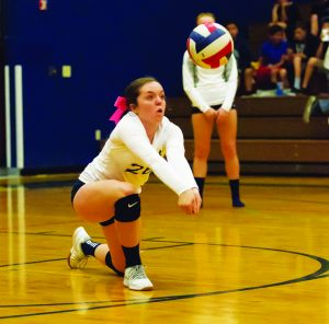 Hailey Ernest digs to make the play.   The Ladycats concluded the regular season with West Wendover on Wednesday.