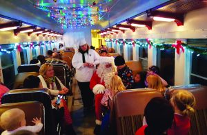 Nevada Northern Railway photo Santa on board the train. The Polar Expess has arrived at the North Pole. Santa is on board visiting with all the passengers