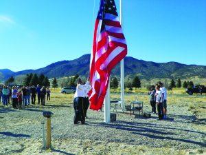 Teresa Stewart photo Color Guard raising the POW MIA flag during the dedication of two new flag poles at the VFW facility.