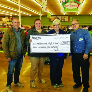 Times Photo/KAYLYNN ROBERTS-MCMURRAY Shopko presents a check for $2,500 to WPHS. Pictured:Roger Dunnavant, Assistant Dean at David E. Norman Elementary, Carolyne Murphy, parent volunteer with new GATE program at DEN,  Cammie Briggs, Principal David E. Norman Elementary. and Tom Sandt, Manager at Shopko