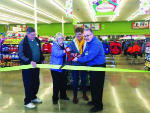 Times photo/KAYLYNN ROBERTS-MCMURRAY Wayne Cameron, Chamber of Commerce executive director, Lorraine Clark, Chamber of Commerce president, Melody VanCamp, city mayor, Tom Sandt, manager at Shopko