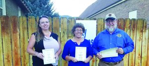 Times photo Teresa Stewart, Shari Gilson and Mark Bassett showing their awards won from the Nevada Press Association.