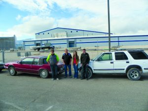 Courtesy photo Students along with Brett Hermansen standing by donated cars from Sahara Motors.
