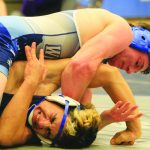Bobcats medal three at state wrestling