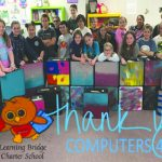 Simplistic Solutions donates  computers to students at Learning Bridge