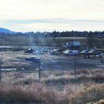 Abandoned vehicles fill lot near sewer treatment facility
