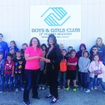 Dispensary gives money  to Boys & Girls Club