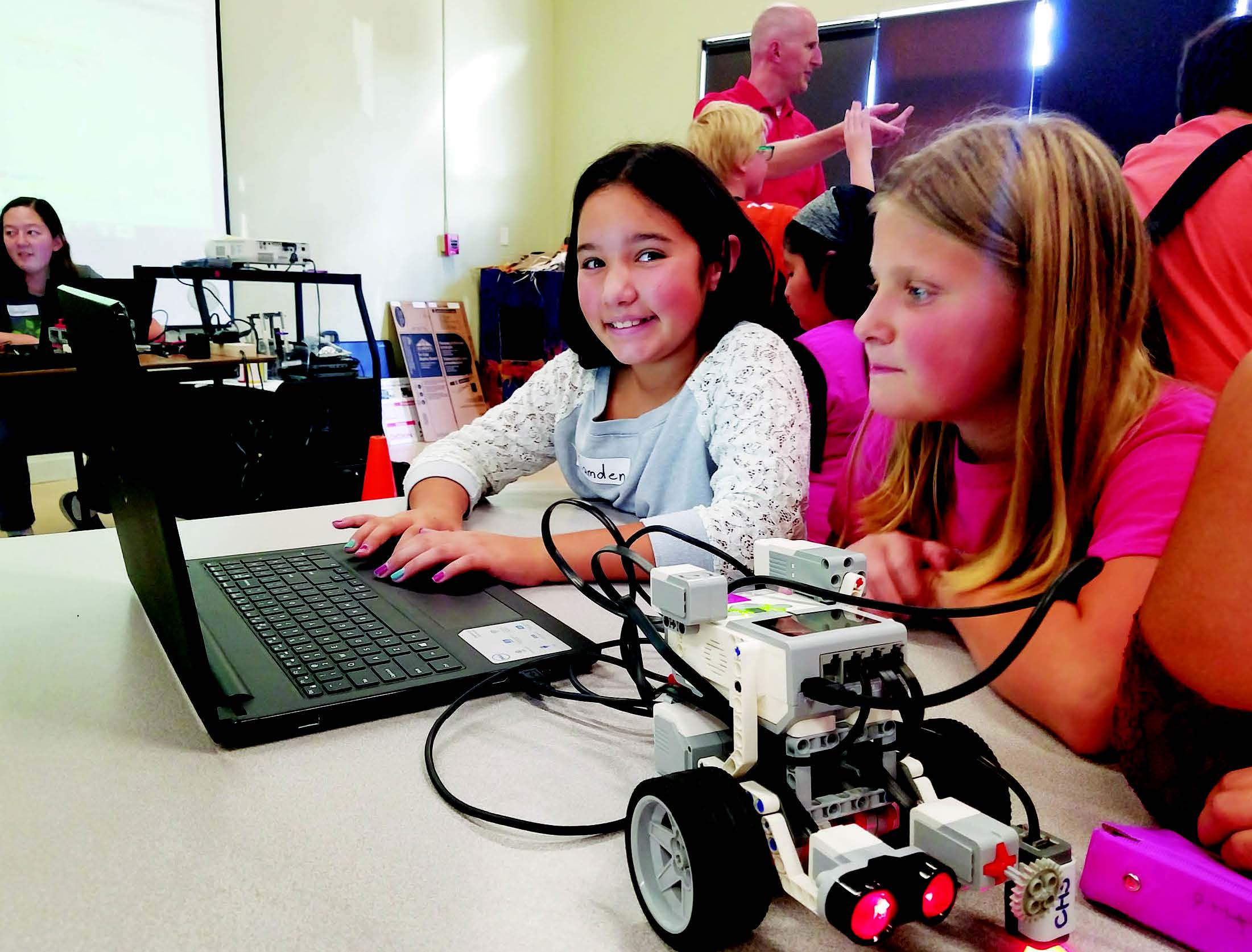 Submitted photo  Camden Johnson and Hazel Williams learning how to program at a robotics workshop in Elk