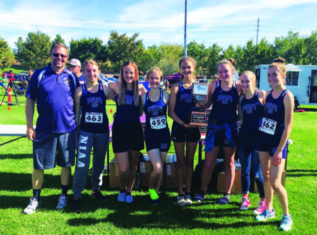 Submitted photo State Runner ups with their trophy. From left: Coach Darin Stewart, Kaycee Schulz, Bethany Lister, Rylie Evers, Odessa Stewart, Halle Cogley, Devin Pickens, Bailey Schulz.