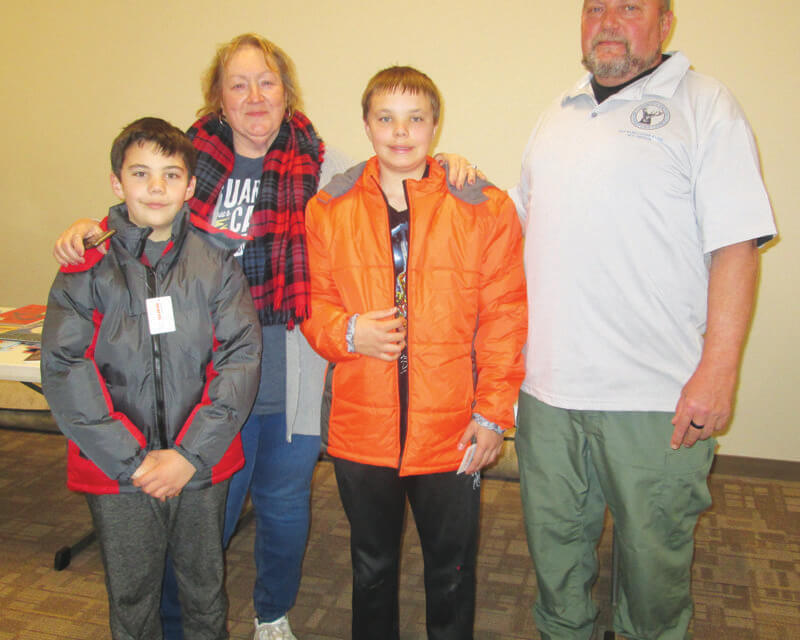 Ely Elks give new coats to kids in need